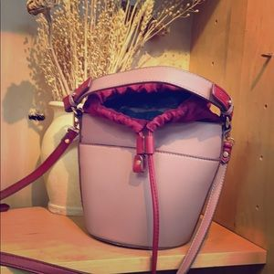 Pink bucket bag with red accents